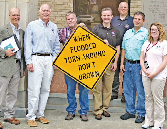 Some of the participants at the Turn Around, Don't DrownTM dedication at Pocahontas (Randolph County) on 06/22/2017 included (from left) Jim Belles, Meteorologist in Charge at the National Weather Service in Memphis, TN, Steve Drillette, Meterolologist in Charge at the National Weather Service in Little Rock, AR (WFO LZK), Randolph County Judge David Jansen, Warning Coordination Meteorologist Dennis Cavanaugh from WFO LZK, Northeast Arkansas Coordinator Anthony Coy, Randolph County Emergency Manager Bo Graham, and Senior Service Hydrologist Tabitha Clarke from WFO LZK. The photo is courtesy of the Pocahontas Star Herald.