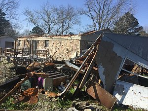 Structures were damaged near Higginson (White County).