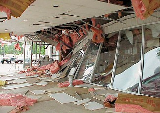 A sales building at an auto dealership was heavily damaged in Benton (Saline County).