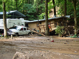 Property damage was extensive, with numerous cabins and vehicles affected.