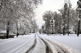 There were ruts in a few neighborhood roads in Sherwood (Pulaski County) to start the morning on 12/26/2012. Otherwise, most roads were snow covered and hazardous.