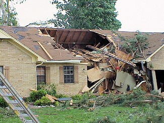 The roof of a home was partially ripped off in McCrory (Woodruff County).
