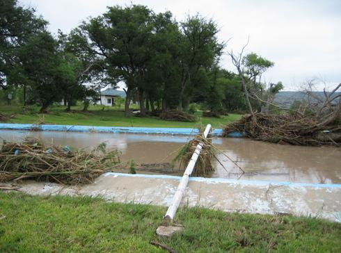 Swimming pool flooded with debris