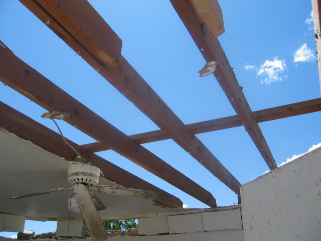 storm damage showing roof removed from a house