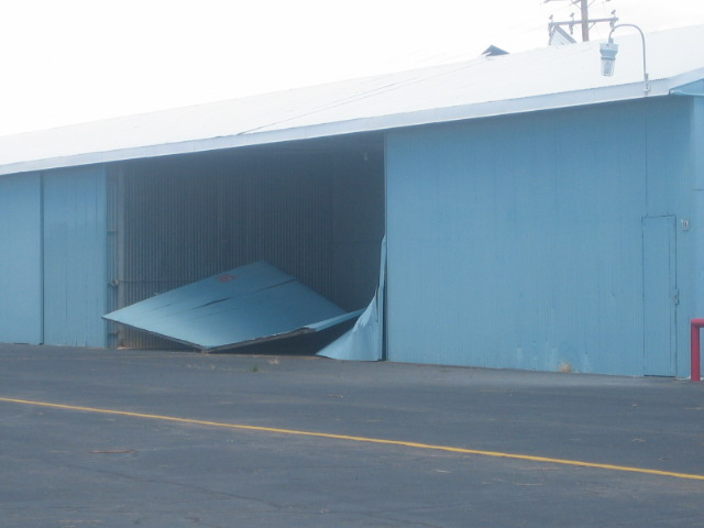 photo showing damage to a hangar