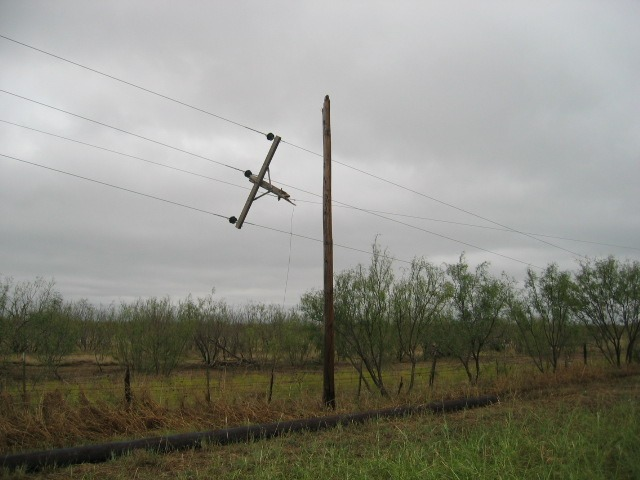Photo of power pole damage along State Highway 137.