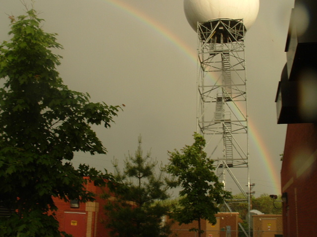 Rainbow forms behind radar at WFO Marquette - July 2004