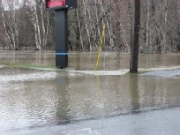 Photograph of flooding of the Ft. Kent, ME Credit Union on Main Street on April 30, 2008