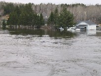 Photograph of flooding of the Fish River near Route 161 in Fort Kent, ME on April 30, 2008