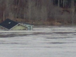 Photograph of a home flooded along the St. John River in Fort Kent, ME on April 30, 2008