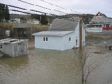 Photograph of homes flooded along  the St. John River on East Main Street in Fort Kent, ME on April 30, 2008