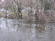 Photograph of the Sudbury River flooding a house on Stonebridge Road in Wayland, MA