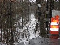 Photograph of the Sudbury River flooding Pelham Island Road in Wayland, MA