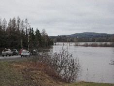 Photograph of a flooded road in Northern Maine on April 30, 2008