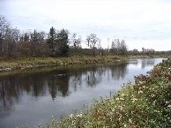 Photograph of the Missisquoi River at East Berkshire, VT (EBKV1) looking upstream