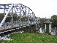 Photograph of the Missisquoi River at Swanton, VT (SWAV1) gage house and bridge bike trail