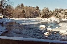 Photograph of river ice along the Black River in Boonville, NY in December 2002 looking upstream
