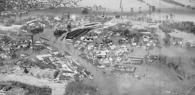 Image of a flooded downtown Nashua, NH as a result of heavy rain and snowmelt in March 1936.