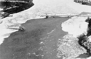 Image of a highway bridge destroyed by ice flows on the Kennebec River in Maine, March 1936.