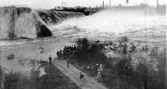 Picture of Holyoke Power Dam with nearly 15 feet of water flowing over its top (at peak flow during the November 1927 flood).