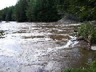 Photograph of the Missisquoi River at North Troy, VT (NTYV1) during high flow