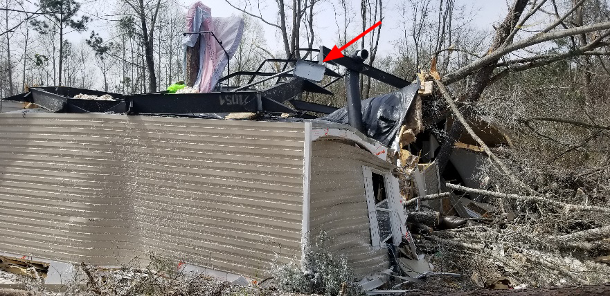 Photo – Surface mount pan anchor still attached to home frame (Lee County, Alabama - March 2019).