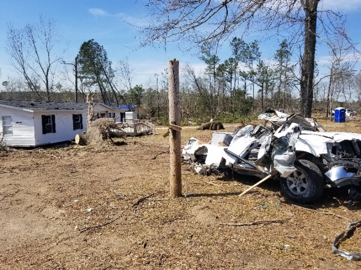 Photo - Manufactured home structurally intact, vehicle destroyed (Lee County, Alabama - March 2019).