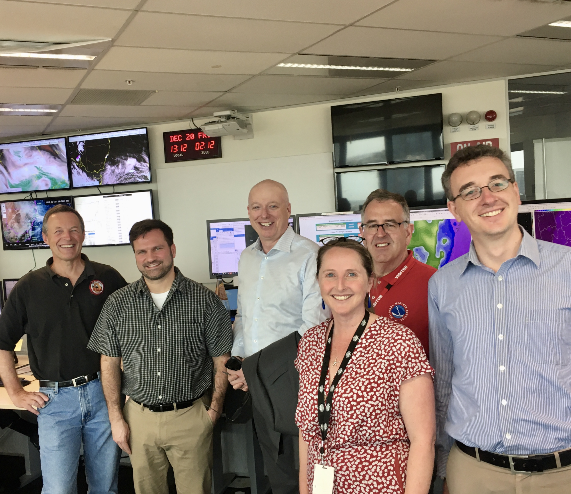 Several IMETs deployed to Australia to help with fire weather forecasting. From left to right: Mark Struthwolf (NWS Salt Lake City, UT), Mark Pellerito (NWS Binghamton, NY), Dr. Andrew Johnson (CEO and Director of Meteorology at the Australian Bureau of Meteorology), Jane Golding (Bureau of Meteorology), in red shirt Joe Goudsward (NWS Little Rock, AR), and Rob Taggart (Bureau of Meteorology). Location: Australian Bureau of Meteorology, Sydney. December 2019. Credit: NOAA
