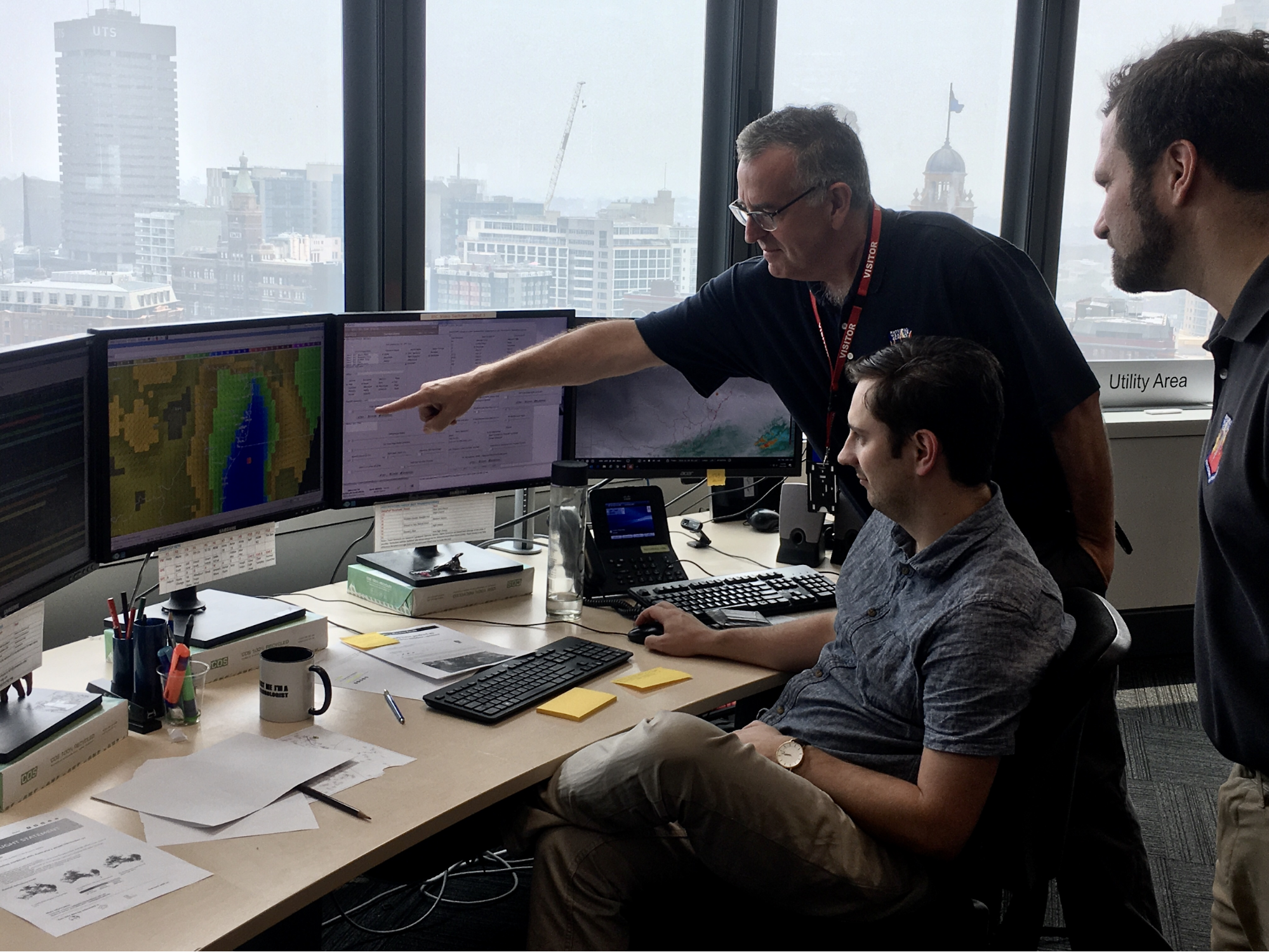 IMET Joe Goudsward (NWS Little Rock, AR) points out potential hazardous weather on a gridded forecast display to an Australian forecaster with IMET Mark Pellerito (NWS Binghamton, NY). Australian Bureau of Meteorology, Sydney, January 2020. Credit: NOAA