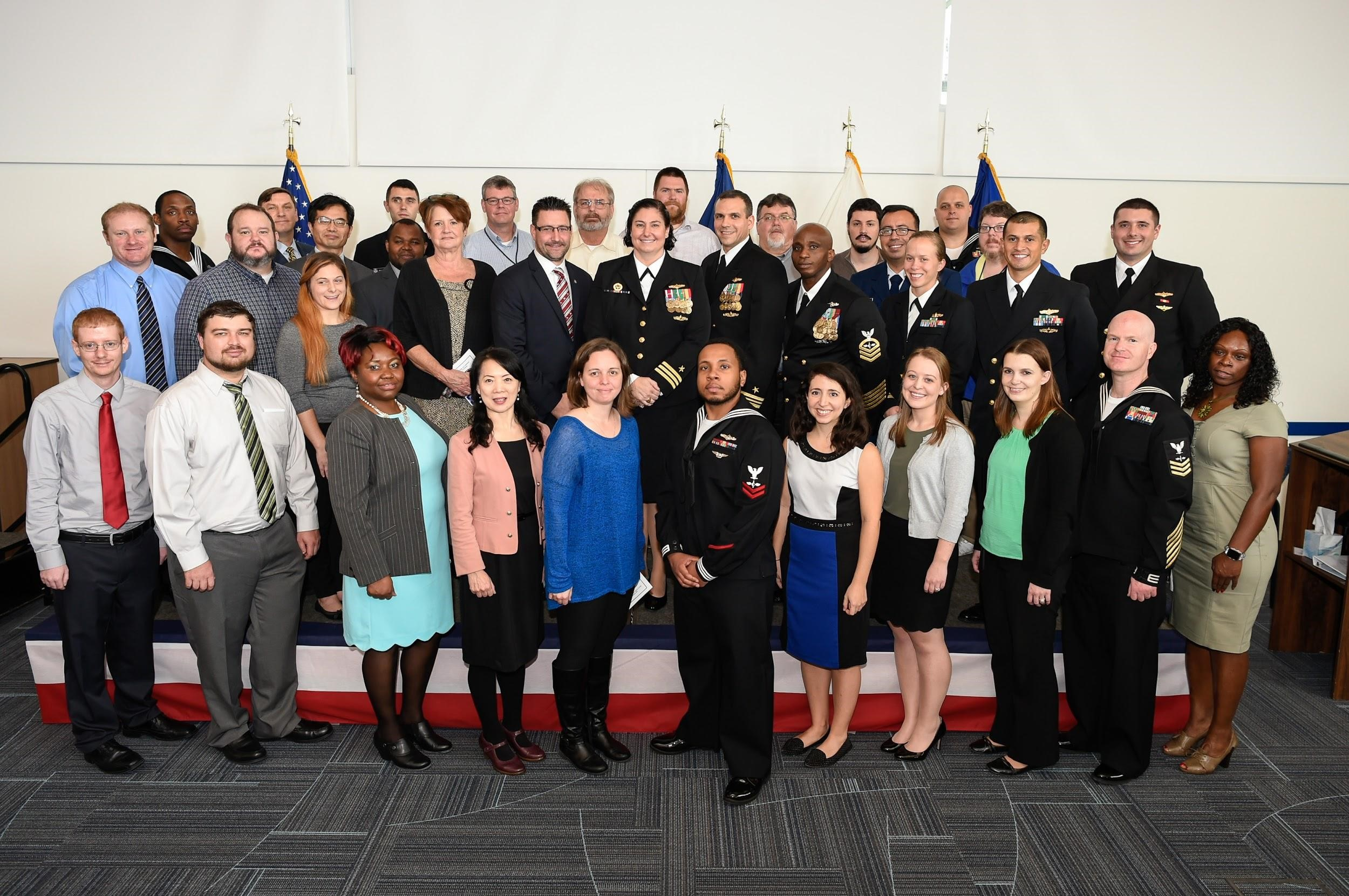 Photo of U.S. National Ice Center (USNIC) personnel captured on November 2, 2018  following the change of command ceremony at the NOAA Satellite Operations Facility. Cmdr. Heather Quilenderino, U.S. Navy (center) is the Director of the tri-agency USNIC and is flanked by Deputy Director (NOAA) Mr. Kevin Berberich (left) and Executive Officer Lt. Cmdr. Joshua Khoury, USN (right).