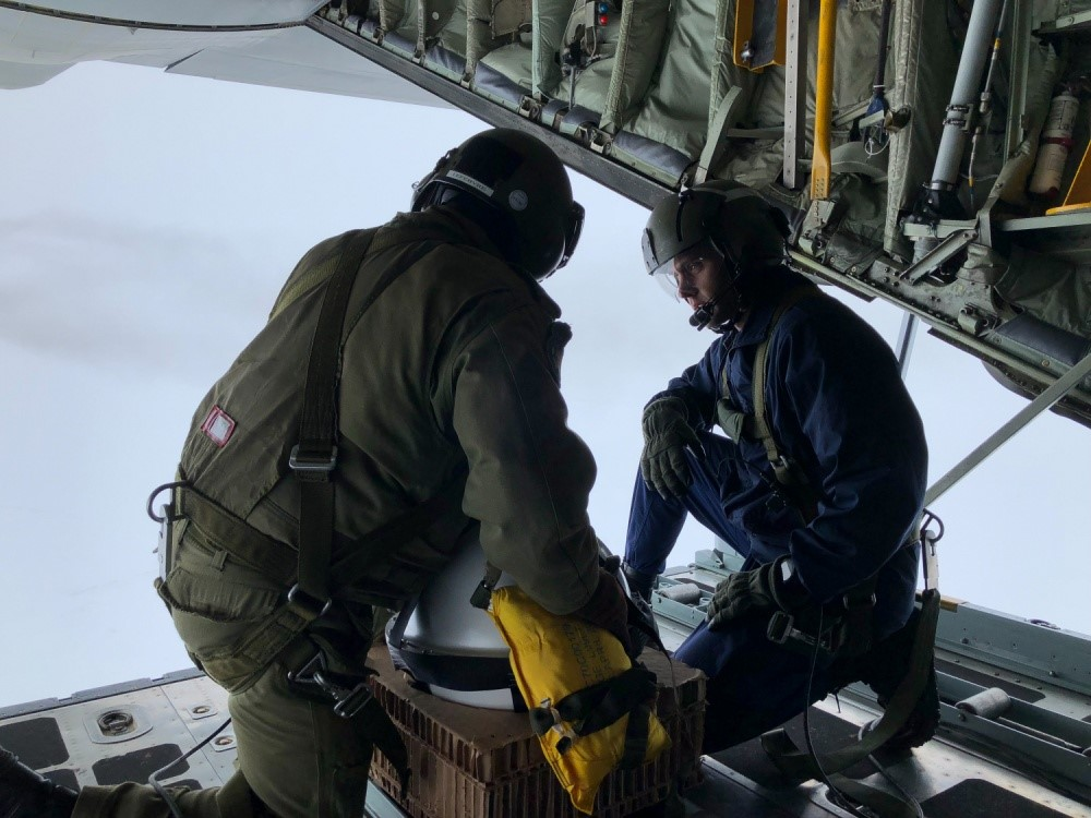 LTJG Bryan Basher, (right), NOAA Corps, USNIC, assists a RCAF loadmaster (left) in the deployment of a U.S. Navy weather buoy. The Naval Ice Center, the primary component of USNIC, is an integral participant in the International Arctic Buoy Program (IABP) managed by Dr. Ignatius Rigor at the University of Washington's Applied Physics Lab. The IABP's in-situ environmental monitoring provides real time satellite validation and continuous input to weather forecast and climate models.