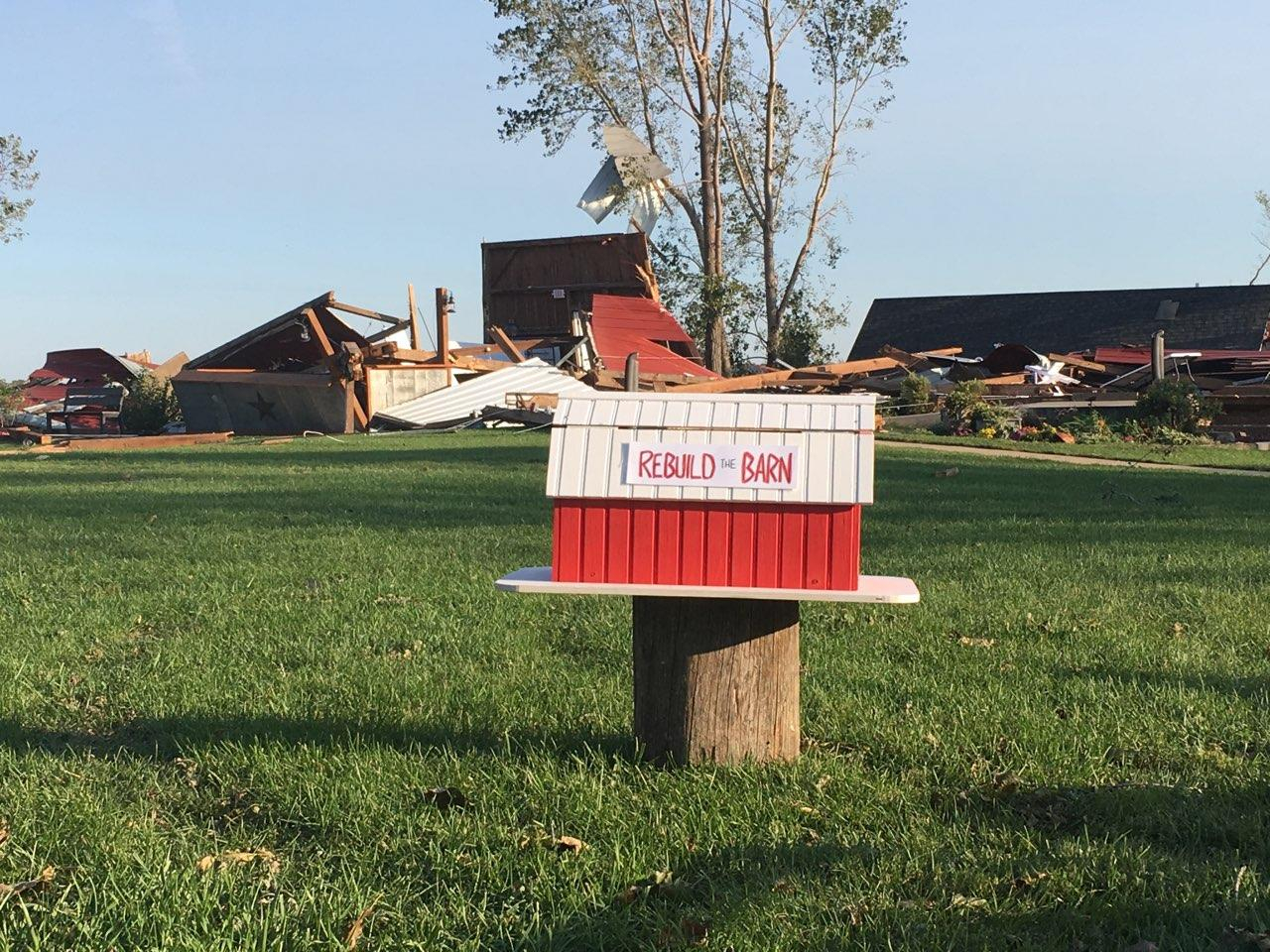Image courtesy of Red Barn Farm webpage showing the destroyed barn in the background. 13 people received the WEA tornado warning on their phone, took shelter underground, and were unharmed from an EF-2 tornado.