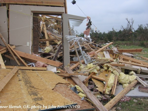 Damage to a home and trees near Harrah, OK.