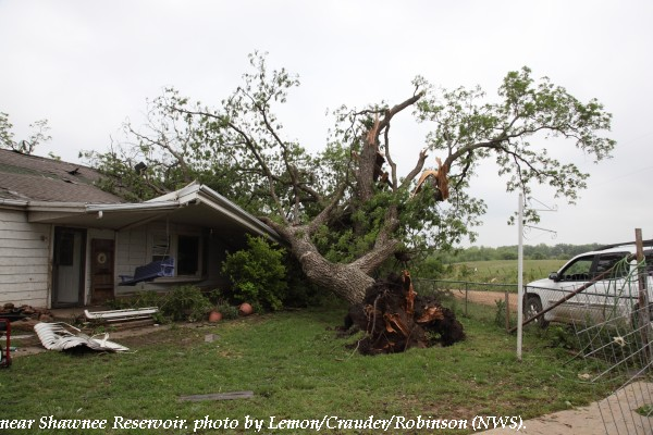 Tree and house damage west of Shawnee, OK.