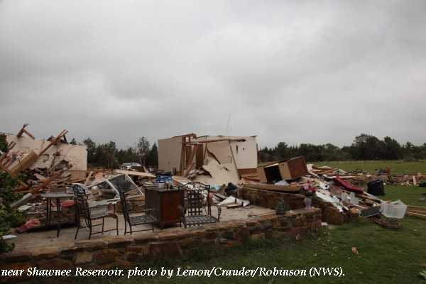 Home damage west of Shawnee, OK.
