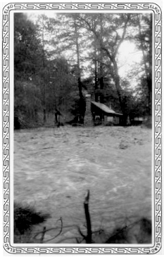 This photo depicts a flooded cabin along the Rio Ruidoso in the village of Ruidoso, where 15 cabins were destroyed or damaged.