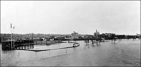 Floodwaters from the Mississippi River inundate downtown Davenport, Iowa and John'Donnell Stadium in April 1965. Photo by the Quad City Times.