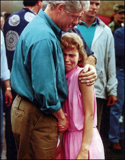 President Bill Clinton comforts a Des Moines, Iowa area resident during his visit to survey the flood damage in Des Moines on July 14, 1993. Photo by the Des Moines Register