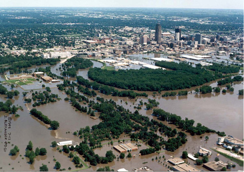 Floodwaters from the Raccoon River inundate downtown Des Moines, Iowa and Des Moines Water Works on July 11, 1993. Photo by Des Moines Water Works.