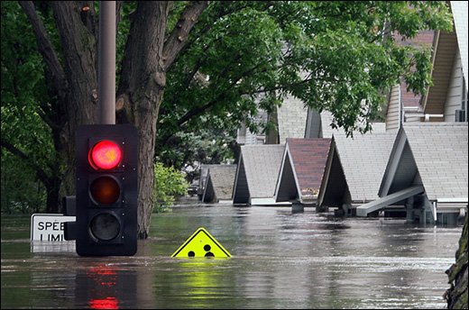The Cedar River floods a neighborhood in Cedar Rapids, Iowa in June 2008. Photo by Scott Olson/Getty Images.