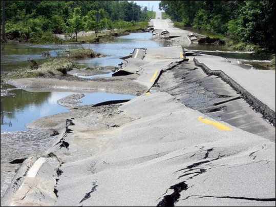 Significant damage to U.S. Highway 6 becomes apparent after the Cedar River subsides east of Atalissa, Iowa in June 2008. Photo by the Iowa Department of Transportation.