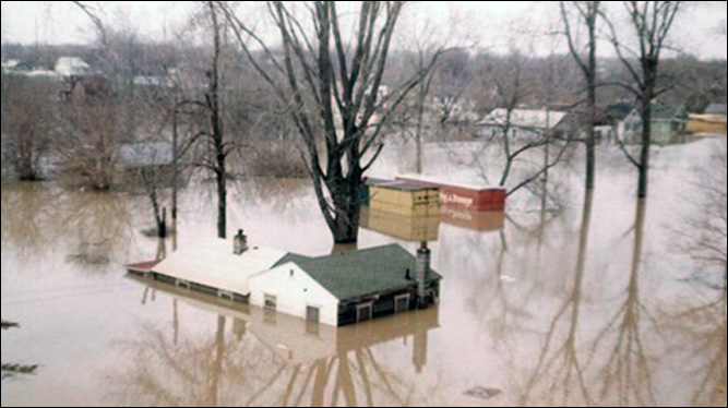 Houses almost completely under water. Credit: Lansing State Journal file photo