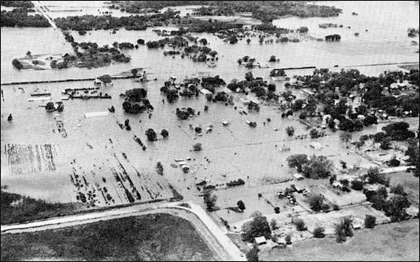 Flooding on the Turkey Creek at Dover, OK on May 16, 1957. Town inundated except for a small area to which the population was evacuated. (Photo was provided courtesy of the Oklahoma Times and is from USWB Technical Paper No. 3, p. 64.)