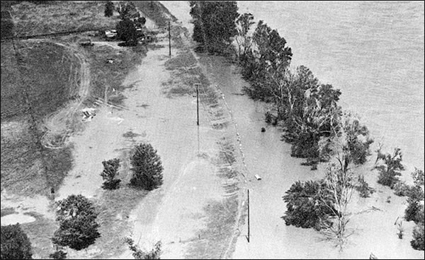 Flooding on the Arkansas River at Tulsa, OK, near 41st Street on May 21, 1957. Note the floodwaters over low levee on west side of the Arkansas River near Garden City. (From USWB Technical Paper No. 3, p. 65.)