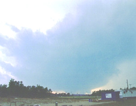 Wall cloud and tornado near the Texas and Louisiana state line