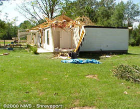 Roof damage to a home in Jena, LA
