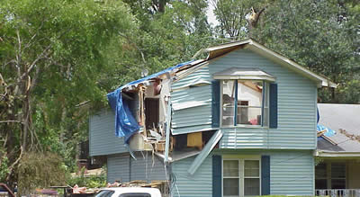 A tree fell on this house injuring a person inside