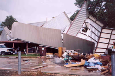 Boat storage building tossed onto a residence near Quitman, TX