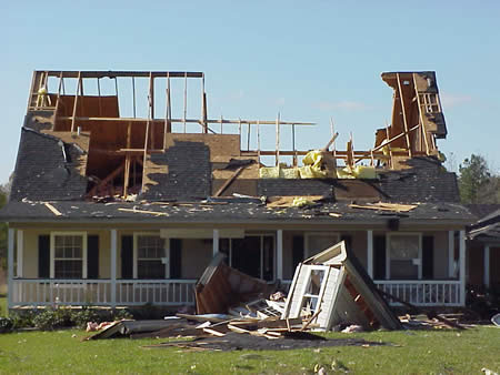 Severe damage to a house in Holum, LA