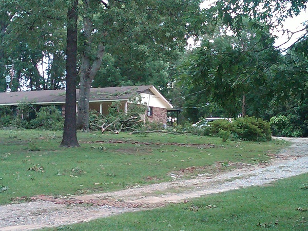 Damage to a home caused by falling trees northeast of Farmerville.